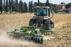 Tractor at work. During the wheat harvest in Tuscany Royalty Free Stock Photo