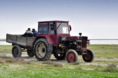Tractor and workers Royalty Free Stock Images
