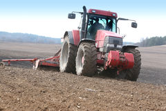 Tractor working. On the field Stock Image