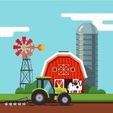Tractor working on a arable field. Farm scenery barn, grain silo, and tractor working on a arable field with attached plough. Modern flat style vector Royalty Free Stock Photography