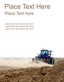 Tractor Working At The Field Stock Images