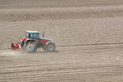 Tractor working on the field Stock Photos