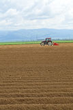 Tractor working in the field Royalty Free Stock Photo