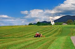 Tractor working in the field Stock Images