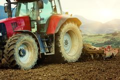 Tractor working on field Stock Image
