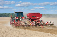Tractor working in the field. Royalty Free Stock Photo