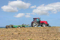 Tractor working in the field. Stock Photos