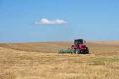 Tractor working in the field. Royalty Free Stock Image