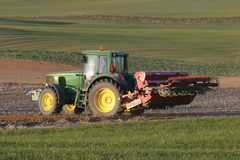 Tractor working on the field Royalty Free Stock Images