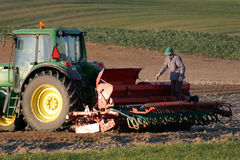 Tractor working on the field. Spring time Stock Images