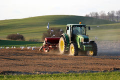 Tractor working on the field. Spring time Stock Photography