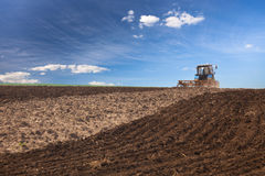 Tractor working on the field Royalty Free Stock Photo