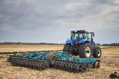 Tractor working in field Stock Photo
