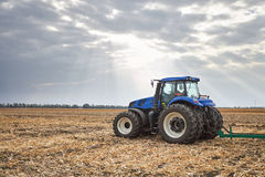 Tractor working in the field in autumn Royalty Free Stock Image