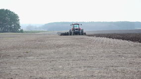 Tractor working in the field stock video footage