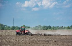 Tractor working on the field, a modern agricultural transport, cultivation of land. Tractor working on the field, a modern agricultural transport, fertile land royalty free stock photography