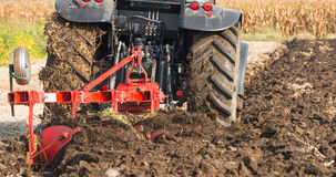 Tractor working in the field Stock Image