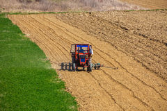 Tractor working in a field. At spring Stock Image
