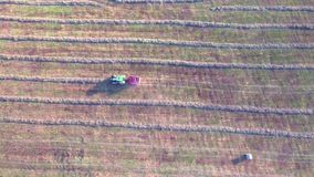 Tractor working in fields aerial view stock video footage