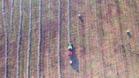 Tractor working in fields aerial view stock footage