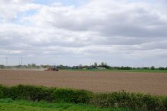Tractor working land. Tractor working arable land during a very dry dusty spell in spring Stock Photos