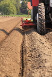 Tractor working the land straight lines Royalty Free Stock Photos