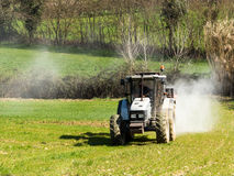 Tractor working spreading fertiliser Royalty Free Stock Photo