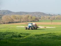 Tractor working spreading fertiliser Royalty Free Stock Images