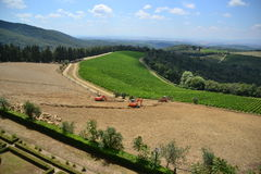 Tractor working in Tuscany Royalty Free Stock Images