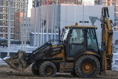 Tractor works on a construction in Moscow stock photos
