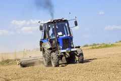 Tractor works in the field Stock Image