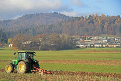 Tractor works in the field nearly Ljubljana Stock Image