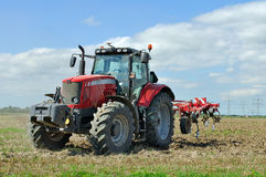 Tractor works at field with plough Royalty Free Stock Photography