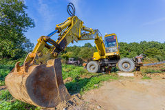 Tractor. Yellow tractor on construction site Stock Photo