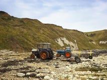Tractoren en bootaanhangwagens Royalty-vrije Stock Afbeeldingen