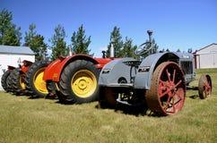 Tractores de los tractores de McCormick Deering y de Massey Harris Foto de archivo libre de regalías