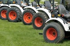 Tractores en línea Foto de archivo libre de regalías