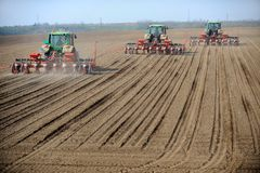 Tractors. Seeding - tractors working on a field Royalty Free Stock Photo