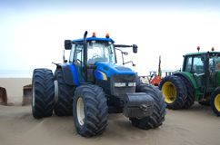 Tractors on the beach Stock Image