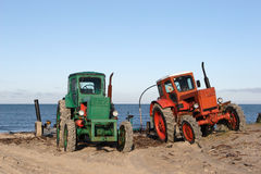 Tractors an a beach Royalty Free Stock Photo