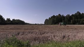 Tractors on cereal field stock footage
