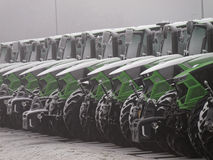 Tractors Deutz-Fahr vehicle fleet in winter. A fleet of agricultural vehicles lined up in the outdoor car park. Production place of Deutz-Fahr company in Stock Photography
