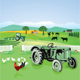 Tractors in farm fields Royalty Free Stock Photo
