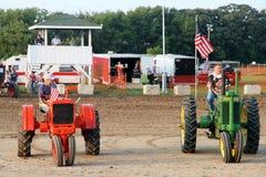 Tractors Farmall and John Deere Royalty Free Stock Photos