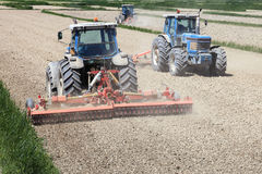 Tractors farming Stock Images