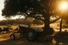 Tractors in a field stock images
