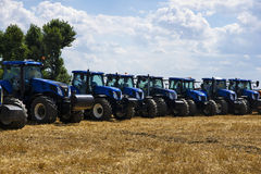 Tractors in the field, aligned in a row Stock Images