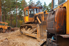 Tractors in the forest Royalty Free Stock Photos