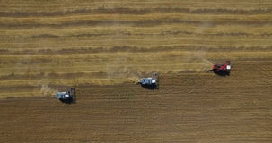 Tractors on harvest field stock video
