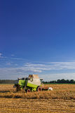 Tractors and harvesting Stock Images